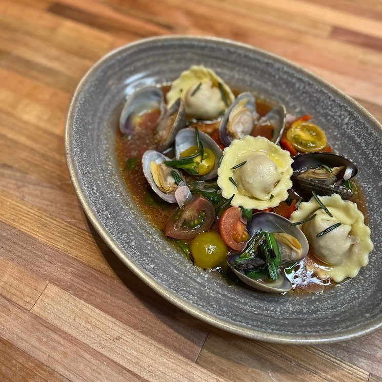 Rioja's housemade pasta stuffed with sausage in a saucy clam, tomato and garlic broth.